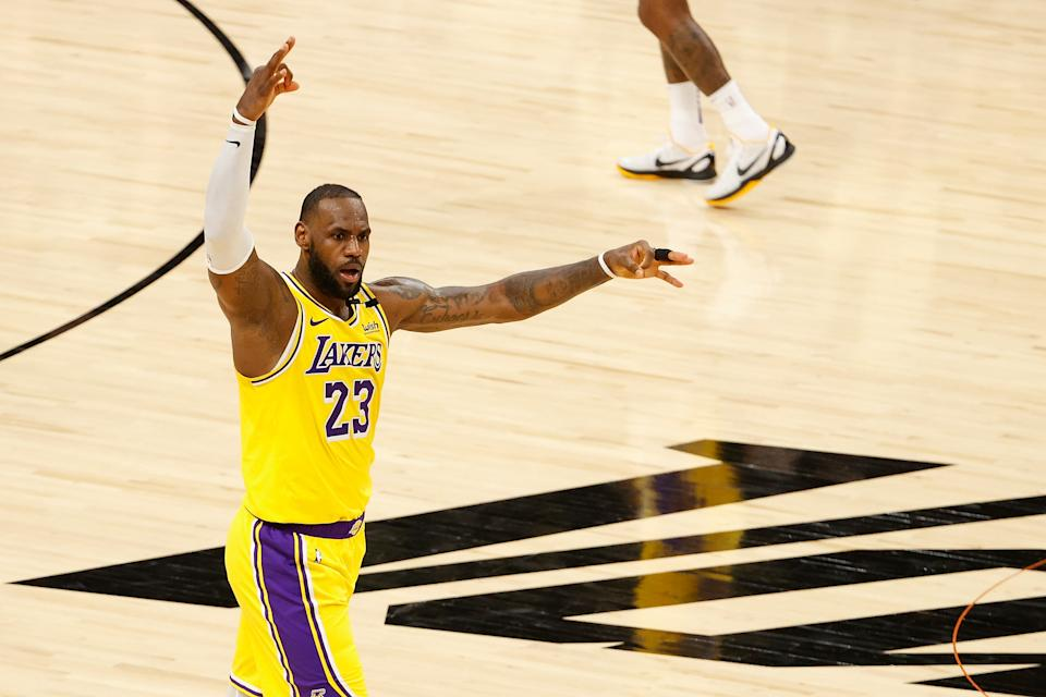 PHOENIX, ARIZONA - MAY 25: LeBron James #23 of the Los Angeles Lakers reacts to a three-point shot against the Phoenix Suns during the second half of Game Two of the Western Conference first-round playoff series at Phoenix Suns Arena on May 25, 2021 in Phoenix, Arizona. NOTE TO USER: User expressly acknowledges and agrees that, by downloading and or using this photograph, User is consenting to the terms and conditions of the Getty Images License Agreement.  (Photo by Christian Petersen/Getty Images)