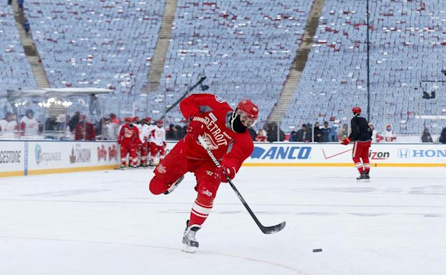 Detroit Red Wings forward Henrik Zetterberg (40), of Sweden, shoots a puck during practice on the outdoor rink for the NHL Winter Classic hockey game against the Toronto Maple Leafs at Michigan Stadium in Ann Arbor, Mich., Tuesday, Dec. 31, 2013. The game is scheduled for New Year's Day. (AP Photo/Paul Sancya)