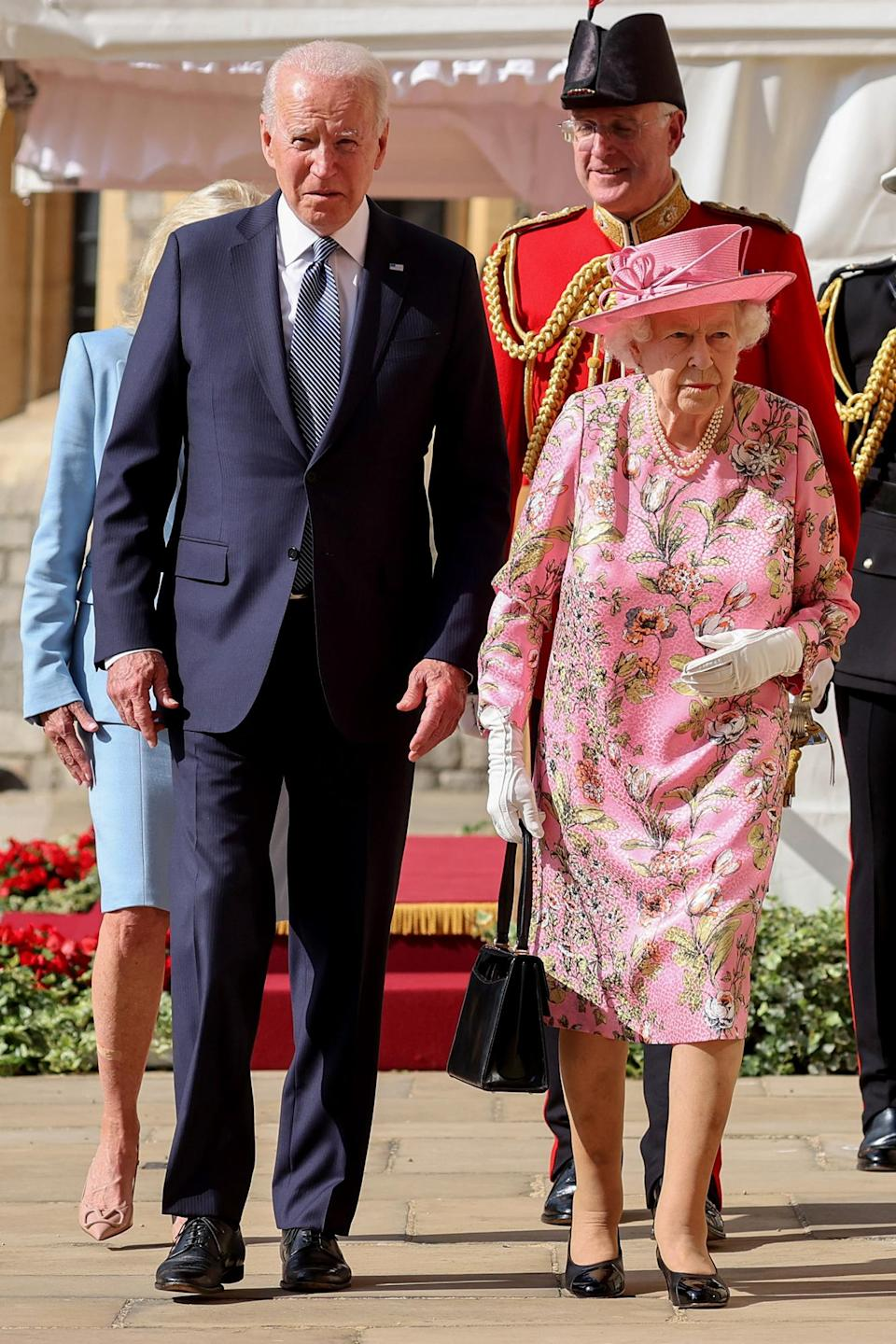 """<p>During their meeting, the president and Queen discussed world leaders Vladimir Putin and Xi Jinping, as well as <a href=""""https://people.com/royals/joe-biden-queen-elizabeth-meeting-g7-summit-visit/"""" rel=""""nofollow noopener"""" target=""""_blank"""" data-ylk=""""slk:life in the White House compared to Windsor"""" class=""""link rapid-noclick-resp"""">life in the White House compared to Windsor</a>.</p> <p>""""I said ... we could fit the White House in the courtyard,"""" the President joked of the castle, adding that he extended the Queen an invite to the White House.</p>"""