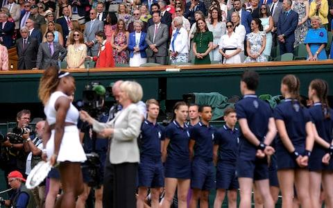 Members of the Royal Family watch on as Serena Williams talks to Sue Barker - Credit: Laurence Griffiths/Pool Photo via AP