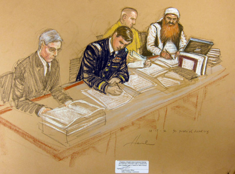 In this photo of a sketch by courtroom artist Janet Hamlin and reviewed by the U.S. Department of Defense, Khalid Sheikh Mohammed, far right, writes on a paper as he sits at the defense table with his legal team, Army Capt. Jason Wright, second from left, lawyer David Nevin, left, and a court translator during the Military Commissions pretrial hearing in the Guantanamo Bay U.S. Naval Base in Cuba, Monday, Oct. 15, 2012. Khalid Sheikh Mohammed, who has portrayed himself as the mastermind behind the Sept. 11 attacks, and four other co-defendants were back before a military tribunal, forgoing the protest that turned their last appearance into an unruly 13-hour spectacle. (AP Photo/Janet Hamlin, Pool)