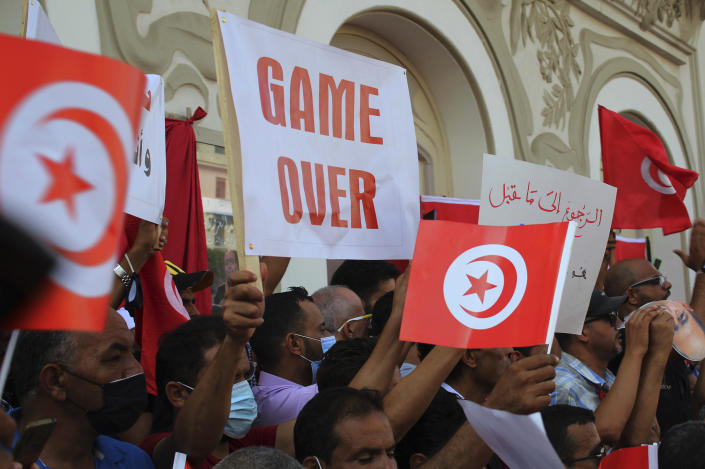Tunisians demonstrate in support of Tunisian President Kais Saied in Tunis, Tunisia, Sunday, Oct. 3, 2021. President Saied froze the country's parliament and sacked the prime minister on July 25, 2021. (AP Photo/Hassene Dridi)