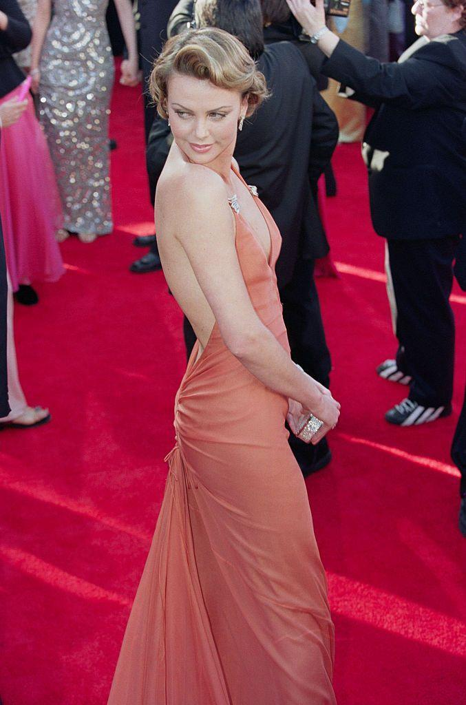 <p>For her first Oscars, the actor wore an orange Vera Wang gown on the red carpet. It would be four years before she won her first Oscar for Monster.</p>