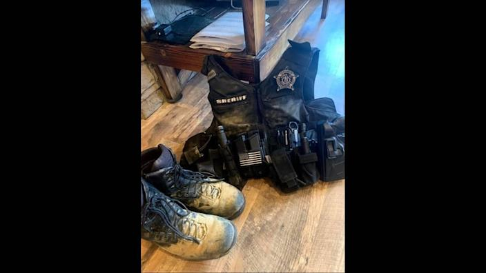 """The gear worn by Edmonson County sheriff's deputies was mud-caked after the """"Redneck Rave"""" in Mammoth Cave, Ky. The sheriff's office charged 48 people over the course of the five-day event."""