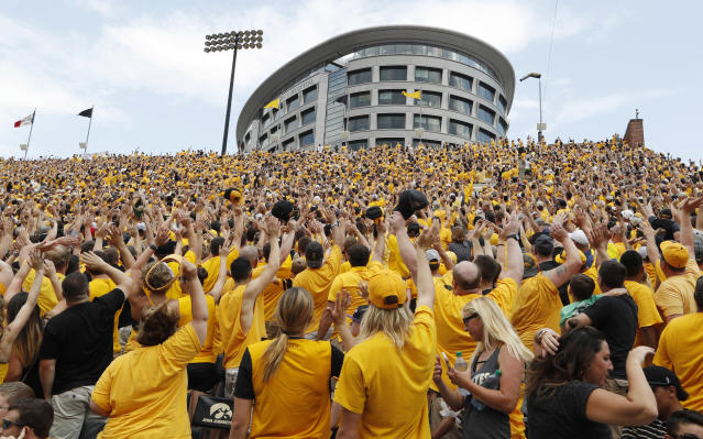 Iowa fans wave to children in the University of Iowa Stead Family Children's Hospital in September 2017. (AP)