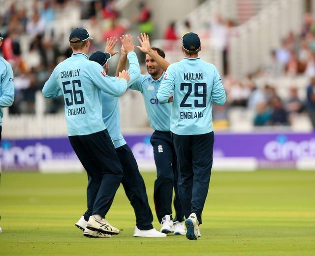 Lewis Gregory (centre) claimed three wickets and scored 40 runs for England