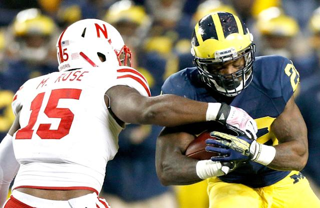 ANN ARBOR, MI - NOVEMBER 09: Michael Rose #15 of the Nebraska Cornhuskers tries to arm tackle Fitzgerald Toussaint #28 of the Michigan Wolverines in the third quarter at Michigan Stadium on November 9, 2013 in Ann Arbor, Michigan. (Photo by Gregory Shamus/Getty Images)