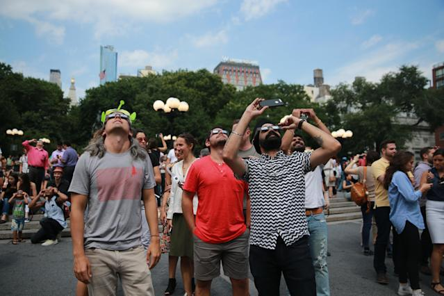 <p>A group of men gather in Union Square in New York to watch the total solar eclipse on Aug. 21, 2017. (Gordon Donovan/Yahoo News) </p>