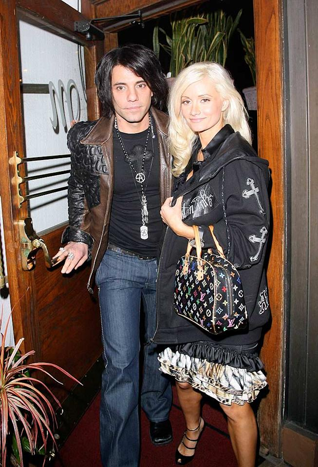 """Criss Angel and his new girlfriend, """"Girls Next Door"""" star Holly Madison, are greeted by the paparazzi as they exit Madeo, an Italian restaurant in West Hollywood. Is that a hickey on the magician's neck? JM-KMax/<a href=""""http://www.x17online.com"""" target=""""new"""">X17 Online</a> - November 20, 2008"""