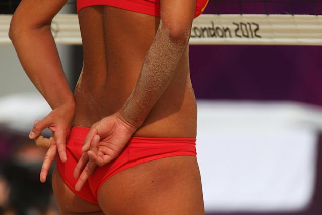 LONDON, ENGLAND - JULY 28: Chen Xue of China signals to team mate Xi Zhang during Women's Beach Volleyball match between China and Russia on Day 1 of the London 2012 Olympic Games at Horse Guards Parade on July 28, 2012 in London, England. (Photo by Alexander Hassenstein/Getty Images)