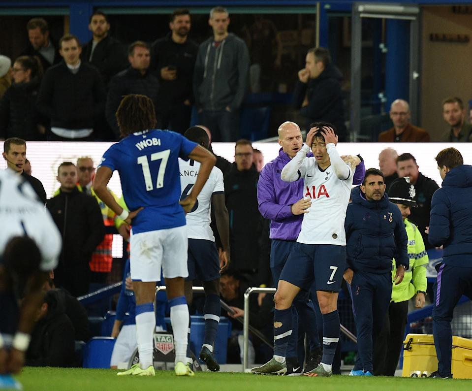 Tottenham Hotspur's South Korean striker Son Heung-Min (C) reacts after his involvement in an incident that resulted in an injury to Everton's Portuguese midfielder André Gomes during the English Premier League football match between Everton and Tottenham Hotspur at Goodison Park in Liverpool, north west England on November 3, 2019. (Photo by Oli SCARFF / AFP) / RESTRICTED TO EDITORIAL USE. No use with unauthorized audio, video, data, fixture lists, club/league logos or 'live' services. Online in-match use limited to 120 images. An additional 40 images may be used in extra time. No video emulation. Social media in-match use limited to 120 images. An additional 40 images may be used in extra time. No use in betting publications, games or single club/league/player publications. /  (Photo by OLI SCARFF/AFP via Getty Images)