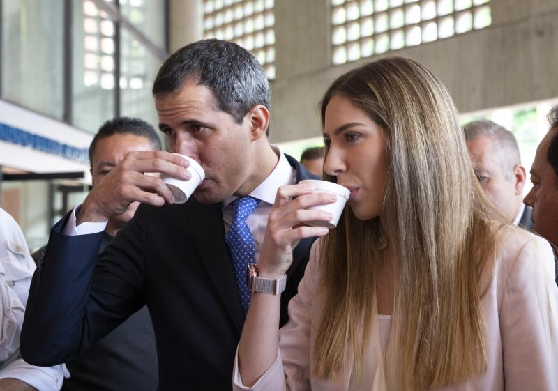 Venezuela's opposition leader and self-proclaimed interim president Juan Guaido and his wife Fabiana Rosales drink coffee, during a congress of agricultural producers, in Caracas, Venezuela, Wednesday, Aug. 14, 2019. (AP Photo/Ariana Cubillos)