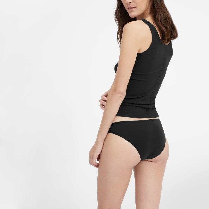 """<h2>Everlane The Bikini</h2><br>This consistently top-purchased pair of briefs prove that breathable underwear is really a year-round staple. Ranked on our list of <a href=""""https://refinery29.com/en-us/best-cotton-underwear-for-women"""" rel=""""nofollow noopener"""" target=""""_blank"""" data-ylk=""""slk:best cotton undies"""" class=""""link rapid-noclick-resp"""">best cotton undies</a>, Everlane's The Bikini receives high marks for being """"The Lightest"""" — with over 1,000 reviews and praise accurately summed up by the following customer comment: """"These are comfy and have a good fit. The cotton is thin and breathable. Overall I really like them. Would order again."""" You can nab a single pair for $15 OR score three for $30. <br><br><em>Shop <strong><a href=""""https://www.everlane.com/products/womens-bikini-black"""" rel=""""nofollow noopener"""" target=""""_blank"""" data-ylk=""""slk:Everlane"""" class=""""link rapid-noclick-resp"""">Everlane</a></strong></em><br><br><strong>Everlane</strong> The Bikini, $, available at <a href=""""https://go.skimresources.com/?id=30283X879131&url=https%3A%2F%2Fwww.everlane.com%2Fproducts%2Fwomens-bikini-black"""" rel=""""nofollow noopener"""" target=""""_blank"""" data-ylk=""""slk:Everlane"""" class=""""link rapid-noclick-resp"""">Everlane</a>"""