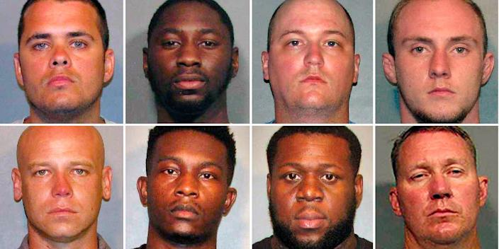 From left, top row: Police officers Aaron Jaudon, D'Andre Jackson, Mark Ordoyne and William Isenhour. Bottom row: Police officers Christopher McConnell, Brandon Walker, Treveion Brooks and David Francis. (Caddo Sheriff's Office via AP)