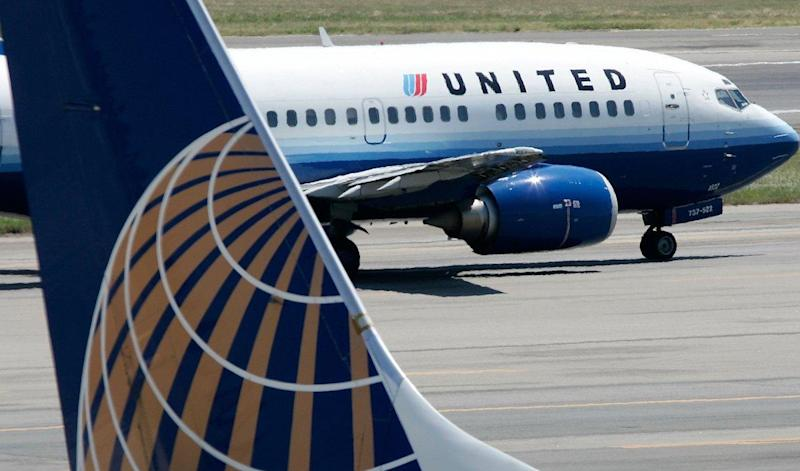 A United Airlines aircraft passes by a Continental Airlines aircraft as it taxis to takeoff from the runway of Ronald Reagan National Airport in Washington DC on August 16, 2006: Alex Wong/Getty