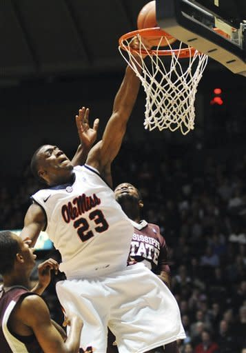 Mississippi's Reginald Buckner (23) dunks over Mississippi State's Arnett Moultrie (23) during an NCAA college basketball game in Oxford, Miss., Wednesday, Jan. 18, 2012. (AP Photo/The Oxford Eagle, Bruce Newman) NO SALES MAGS OUT MANDATORY CREDIT