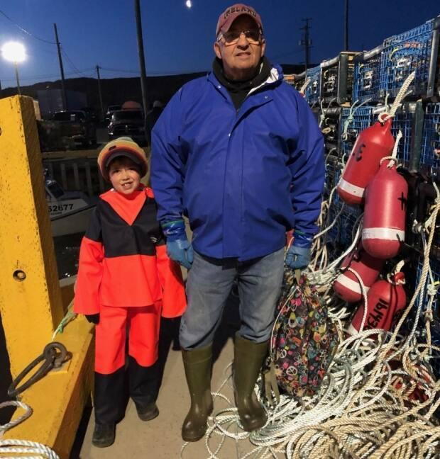 Trent Collins, 7, and his grandfather Keith Daley headed out from the wharf in Stone Haven to set their lobster traps on opening day. Trent has always wanted to join Pa Daley's crew.