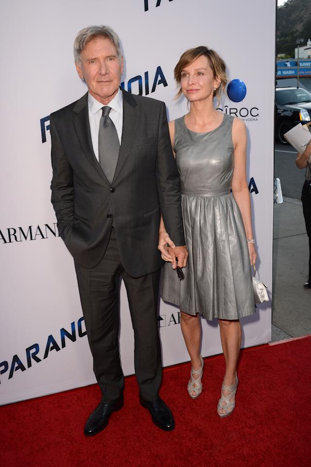 "Actors Harrison Ford and Calista Flockhart arrive at the U.S. premiere of ""Paranoia"" at the DGA Theatre on Thursday, Aug. 8, 2013 in Los Angeles. (Photo by Jordan Strauss/Invision/AP)"
