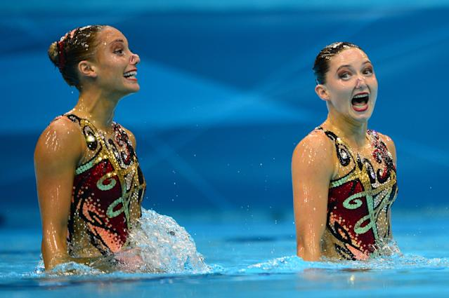 Britain's Jenna Randall and Britain's Olivia Federici compete in the duets technical routine during the synchronised swimming competition at the London 2012 Olympic Games on August 5, 2012 in London. AFP PHOTO / MARTIN BUREAUMARTIN BUREAU/AFP/GettyImages