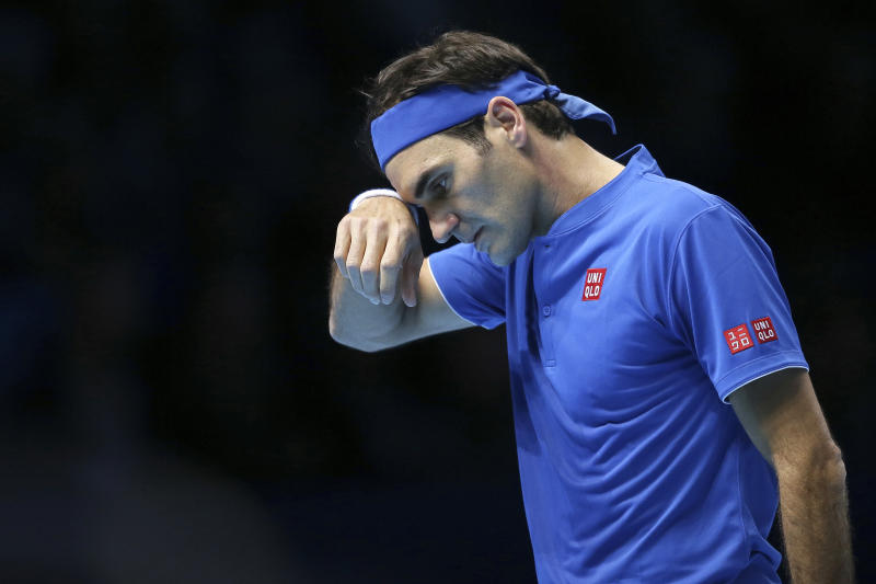Switzerland's Roger Federer wipes his face during his ATP World Tour Finals singles final tennis match against Japan's Kei Nishikori at the O2 Arena in London Sunday Nov. 11 2018