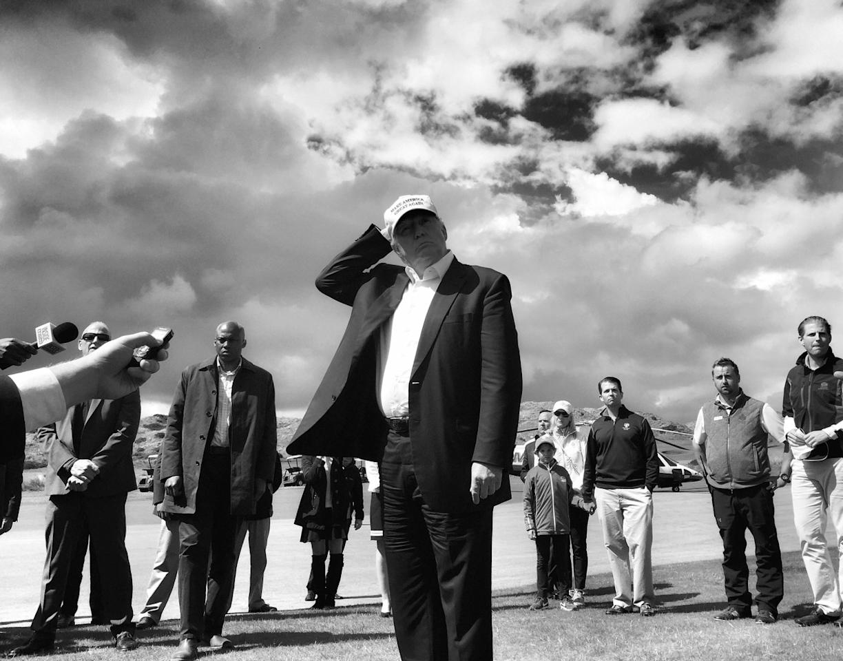 <p>Donald Trump holds on to his hat while speaking to reporters on June 25 at his golf course outside Aberdeen, Scotland. (Photo: Holly Bailey/Yahoo News) </p>