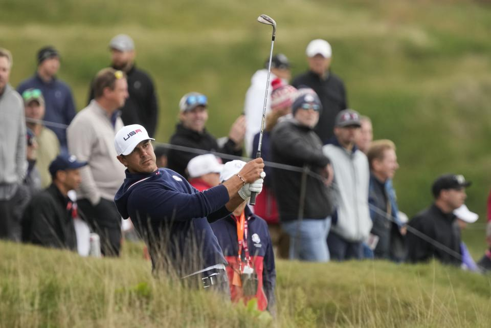 Team USA's Brooks Koepka hits on the fifth hole during a practice day at the Ryder Cup at the Whistling Straits Golf Course Thursday, Sept. 23, 2021, in Sheboygan, Wis. (AP Photo/Charlie Neibergall)