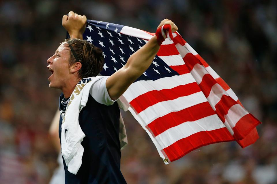 LONDON, ENGLAND - AUGUST 09: Abby Wambach #14 of the United States celebrates after defeating Japan by a score of 2-1 to win the Women's Football gold medal match on Day 13 of the London 2012 Olympic Games at Wembley Stadium on August 9, 2012 in London, England. (Photo by Jamie Squire/Getty Images)