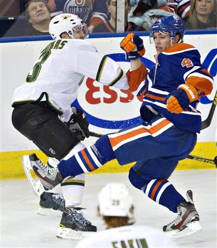 Dallas Stars' Stephane Robidas (3) checks Edmonton Oilers' Taylor Hall during the first period of an NHL hockey game Wednesday, Feb. 6, 2013, in Edmonton, Alberta. (AP Photo/The Canadian Press, John Franson)
