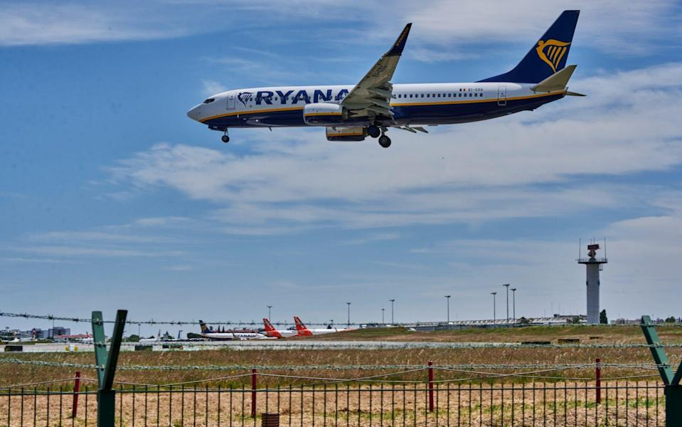 A Ryanair flight from London Stansted lands in Lisbon during the first day of new travel regulations between Great Britain and Portugal - Horacio Villalobos Corbis/Getty Images Europe