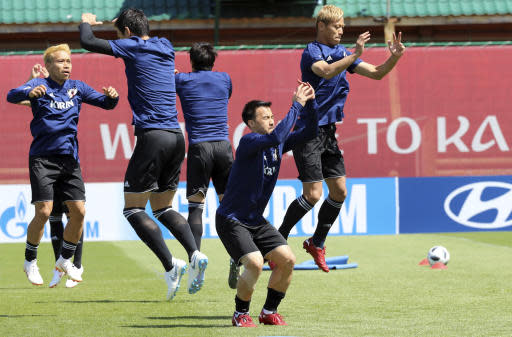 Players warm up during a training session of Japan national team at the 2018 soccer World Cup in Kazan, Russia, Friday, June 22, 2018. (AP Photo/Eugene Hoshiko)