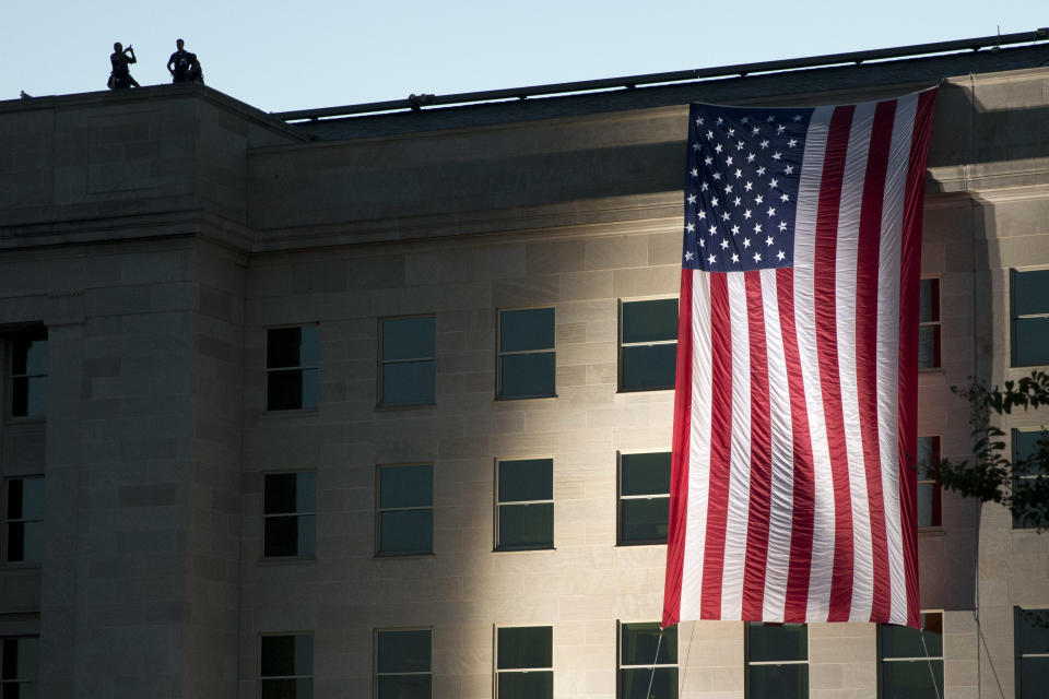 A U.S. flag is draped on the side of the Pentagon, Friday, Sept. 11, 2015, where the building was attacked on September 11th in 2001, on the 14th anniversary of the attack. (AP Photo/Jacquelyn Martin)