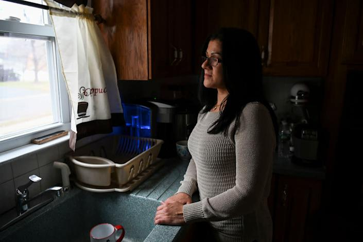 """Sandra Diaz, who worked at the Trump National Golf Club Bedminster before getting her Green Card, poses for a portrait at home in Bound Brook, NJ on January 7, 2019. <span class=""""copyright"""">Photo by Carolyn Van Houten/The Washington Post via Getty Images</span>"""