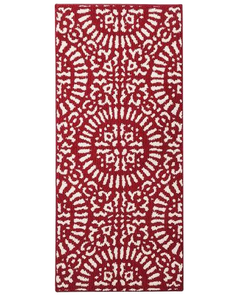 """<p>It would be impossible not to have a cheerful spirit with this red medallion rug in your kitchen. Bonus: It's skid-resistant.<br><em></em><br><em>1'8""""x3'9"""", </em><em>$17, Target  </em><br><a class=""""body-btn-link"""" href=""""https://go.redirectingat.com?id=74968X1596630&url=https%3A%2F%2Fwww.target.com%2Fp%2Fred-medallion-kitchen-rug-threshold-153%2F-%2FA-50874051&sref=http%3A%2F%2Fwww.elledecor.com%2Fshopping%2Fhome-accessories%2Fg10268584%2Fkitchen-rugs%2F"""" target=""""_blank"""">Buy Now </a></p>"""