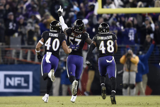 Baltimore Ravens inside linebacker C.J. Mosley, center, celebrates his interception with teammates Kenny Young, left, and Patrick Onwuasor in the second half of an NFL football game against the Cleveland Browns, Sunday, Dec. 30, 2018, in Baltimore. Baltimore Ravens won 26-24. (AP Photo/Gail Burton)