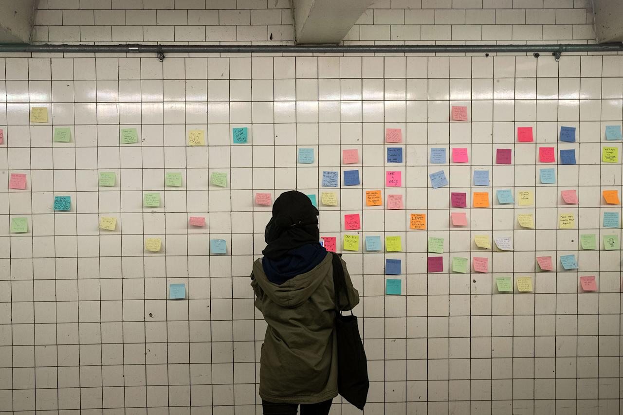 """<p>Post-it notes, many with politically themed messages, hang on a tunnel wall at the 14th Street subway station as part of a public art project entitled """"Subway Therapy"""" on Nov. 10, 201 in New York City. Artist Matthew Chavez, who goes by """"Levee,"""" created the project to offer New Yorkers a chance to write down their feelings in the wake of the presidential election. (Drew Angerer/Getty Images) </p>"""