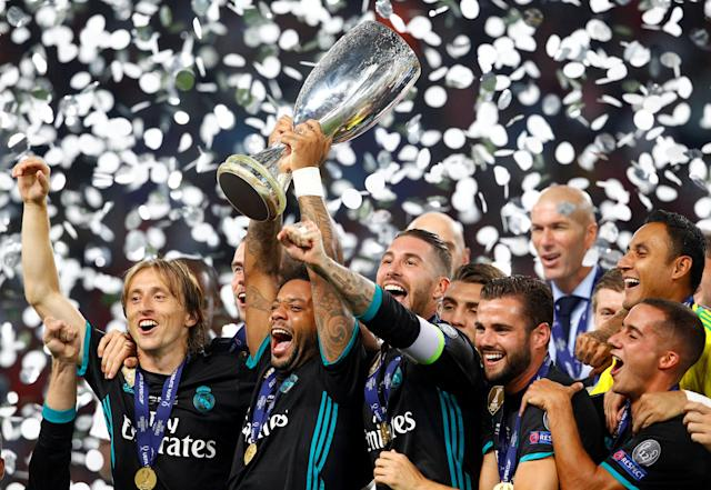 Soccer Football - Real Madrid v Manchester United - Super Cup Final - Skopje, Macedonia - August 8, 2017 Real Madrid's Marcelo lifts the trophy as he celebrates winning the super cup final REUTERS/Ognen Teofilovski TPX IMAGES OF THE DAY