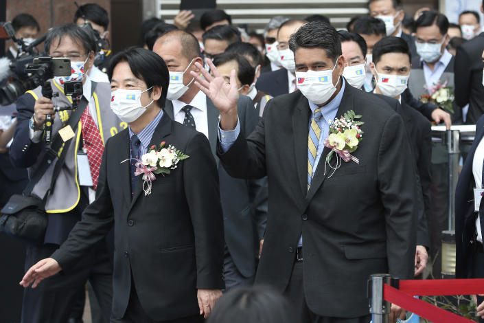 Palau President Surangel Whipps, right, and Taiwan's Vice President William Lai, left, attend a ceremony of opening of the Palau-Taiwan Travel Corridor in Taipei, Taiwan, Tuesday, March 30, 2021. The Palau-Taiwan Travel Corridor, which allows people to travel between the islands without a COVID-19 quarantine, will start on April 1. (AP Photo/Chiang Ying-ying)