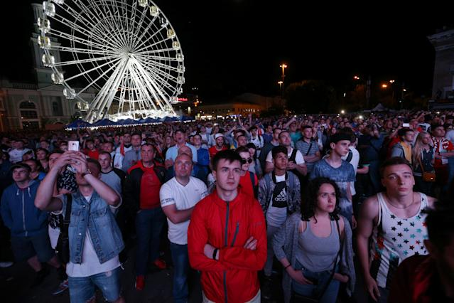 Soccer Football - Champions League Final - Real Madrid v Liverpool - Kiev, Ukraine - May 26, 2018 Fans watching the match on a television screen outside in Kiev REUTERS/Viacheslav Ratynskyi