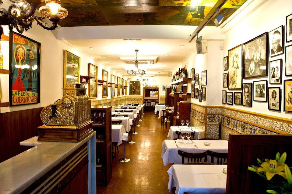 <p><strong>Give us an overview.</strong><br> This iconic restaurant has been around since the late 19th century. It first went by the name Fonda Navarro but has been called Ca L'Estevet since 1940. Back in the day, this was a favorite hangout for Barcelona's artistic community, and the old-school bohemian décor has been preserved: bad lighting, white tablecloths on dark wood, and walls adorned with old portraits and mosaics.</p> <p><strong>What was the crowd like?</strong><br> Locals pack in like sardines here, so it's best to book in advance. Or just get here right when they open, as no self-respecting Spaniard would be caught eating lunch before 2 P.M. By the same standard, you might be able to sneak in for dinner if you come before 9 p.m.</p> <p><strong>What should we be drinking?</strong><br> Bottles of cheap, local red wine and glasses of beer are the drinks of choice.</p> <p><strong>Main event: the food. Give us the lowdown—especially what not to miss.</strong><br> Market-fresh Catalonian cuisine, prepared the way it always has been, with plenty of flavor, love, and olive oil. Top dishes include the cod fritters and meatballs with cuttlefish and prawns.</p> <p><strong>And how did you find the staff?</strong><br> Cozy, warm environment with friendly, personalized service.</p> <p><strong>What's the real-real on why we're coming here?</strong><br> Ca L'Estevet is a great place to get a taste of honest home-style cooking from Barcelona's good old days.</p>