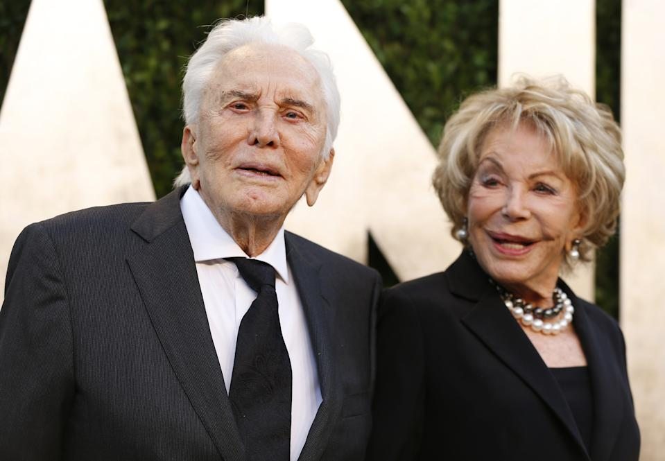 Kirk Douglas and wife Ann Buydens at the 2013 Vanity Fair Oscars Party in West Hollywood, California February 24, 2013.  REUTERS/Danny Moloshok  (UNITED STATES TAGS:ENTERTAINMENT) (OSCARS-PARTIES)