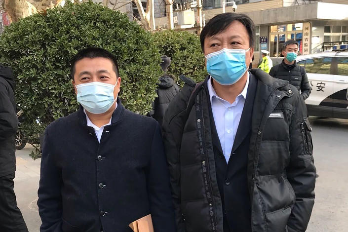 In this photo provided to the Associated Press, Chinese lawyer Ren Quanniu, left, stands with his attorney Bao Longjun outside the Henan provincial Justice Department's office in Zhengzhou in central China's Henan Province, Friday, Jan. 29, 2021. A second Chinese lawyer who represented a Hong Kong pro-democracy activist was stripped of his license amid Beijing's campaign to crush any form of opposition to its tighter control over the territory. (AP Photo)