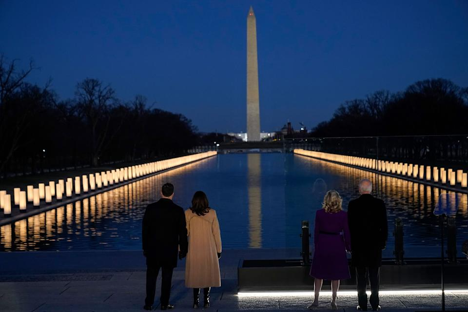 President-elect Joe Biden and his wife Jill Biden, along with Vice President-elect Kamala Harris and her husband, Doug Emhoff, look at lights placed around the Lincoln Memorial Reflecting Pool on Jan. 19, 2021, in Washington. (Photo: AP Photo/Alex Brandon)