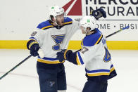 St. Louis Blues' Mike Hoffman, left, celebrates his winning goal with teammate Torey Krug, right, during overtime of an NHL hockey game against the Los Angeles Kings, Friday, March 5, 2021, in Los Angeles. (AP Photo/Marcio Jose Sanchez)