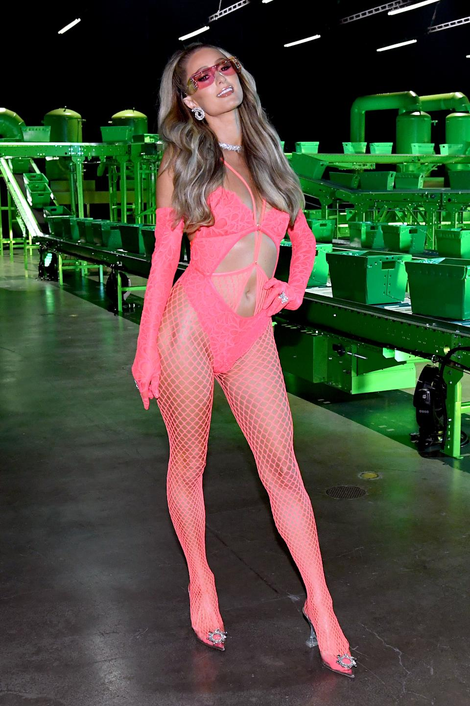 Paris Hilton wears vibrant pink bodysuit with fishnet tights for Savage x Fenty Vol. 2 presented by Amazon Prime Video show.  (Getty Images)