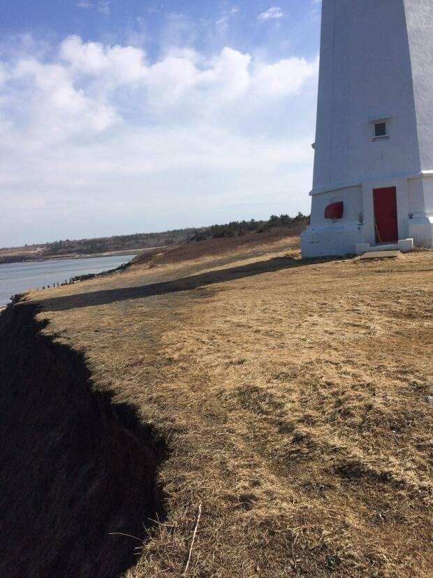Lawrence MacSween, a member of the Low Point Lighthouse Society, says the lighthouse is at risk of falling over the bank.