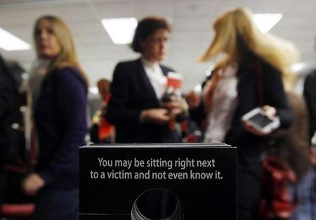 Airline personnel attend a training session at Dallas Fort Worth International Airport to teach them to spot sex-trafficking in Dallas, Texas, January 31, 2011, ahead of NFL football's Super Bowl XLV to be played February 6.  Pimps will traffic thousands of under-age prostitutes to Texas for Sunday's Super Bowl, hoping to do business with men arriving for the big game with money to burn, child rights advocates said. REUTERS/Brian Snyder (UNITED STATES - Tags: SPORT FOOTBALL CRIME LAW IMAGES OF THE DAY) - RTXXC3A