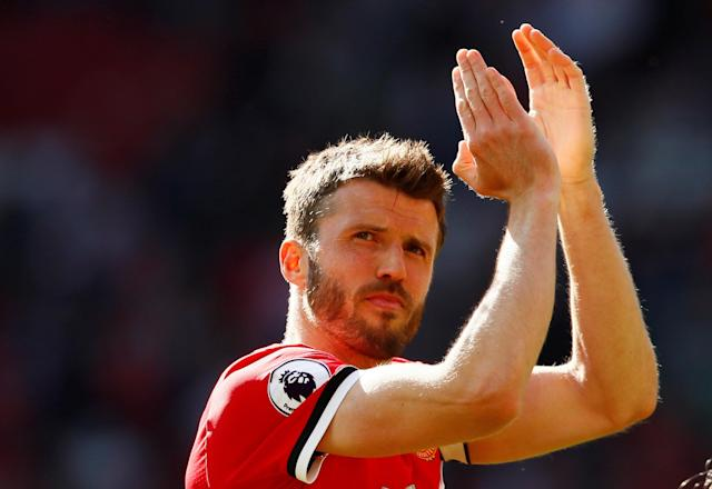 "Soccer Football - Premier League - Manchester United vs Watford - Old Trafford, Manchester, Britain - May 13, 2018 Manchester United's Michael Carrick applauds their fans after the match Action Images via Reuters/Jason Cairnduff EDITORIAL USE ONLY. No use with unauthorized audio, video, data, fixture lists, club/league logos or ""live"" services. Online in-match use limited to 75 images, no video emulation. No use in betting, games or single club/league/player publications. Please contact your account representative for further details."