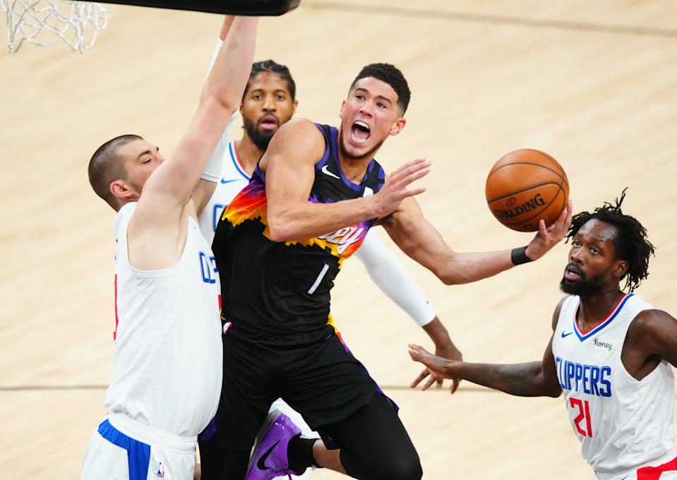 Devin Booker drives to the basket against the Los Angeles Clippers.