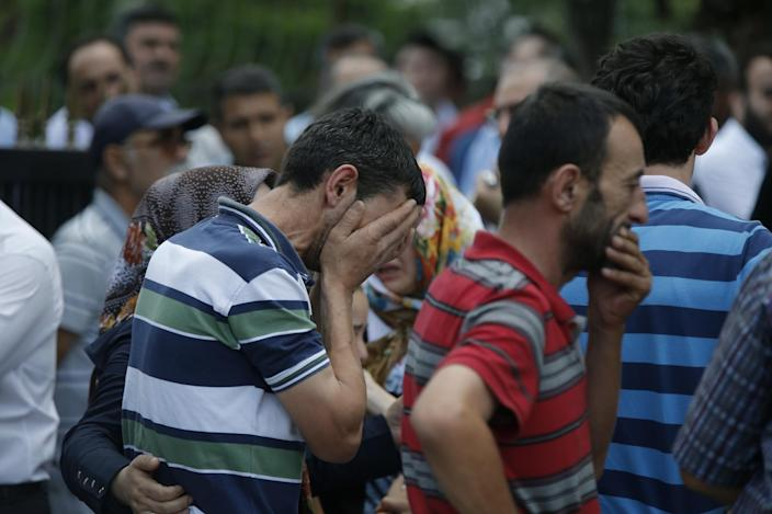 <p>Family members of victims cry outside the Forensic Medical Center in Istanbul, Wednesday, June 29, 2016. Suicide attackers killed dozens and wounded more than 140 at Istanbul's busy Ataturk Airport late Tuesday, the latest in a series of bombings to strike Turkey in recent months. (AP Photo/Emrah Gurel) </p>