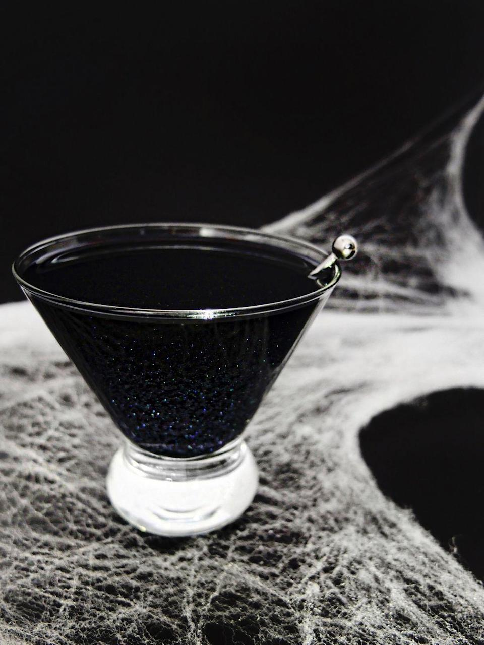 "<p>Scour the shelves at your local liquor stores until you find black vodka — yep, it exists. Then throw in some edible glitter to make it a drink fit for the festivities.</p><p><a href=""https://www.elletalk.com/blog/2016/black-magic"" rel=""nofollow noopener"" target=""_blank"" data-ylk=""slk:Get the recipe from Elle Talk »"" class=""link rapid-noclick-resp""><em>Get the recipe from Elle Talk »</em></a><br></p>"